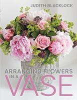 Arranging Flowers in A Vase by Judith Blacklock