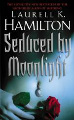 Cover for Seduced By Moonlight by Laurell K Hamilton